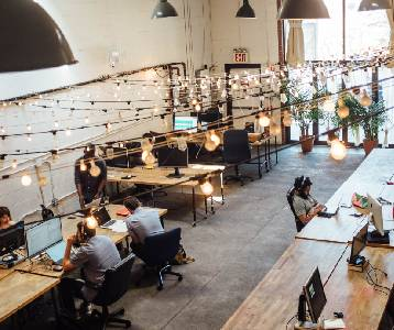Overshot of employees working in a creative space